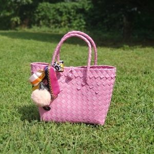 Pink woven hand bag with charm and twilly